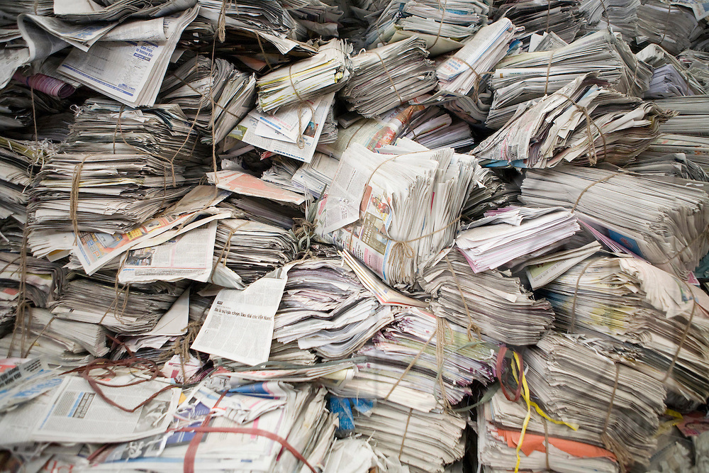 Color film photograph of a pile of discarded daily newpapers in the traditional paper recycling village Duong O, Bac Ninh Province, Hanoi outskirts, Vietnam, Southeast Asia