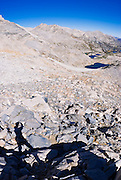 Shadow of climber on the approach to Bear Creek Spire, John Muir Wilderness, Sierra Nevada Mountains, California