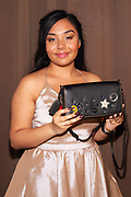 Inspiration Award Honoree Viviana Hurtado with sponsor Coach purse