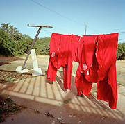 Red pilots' flying suits of the 'Red Arrows', Britain's Royal Air Force aerobatic team, left drying on washing line.