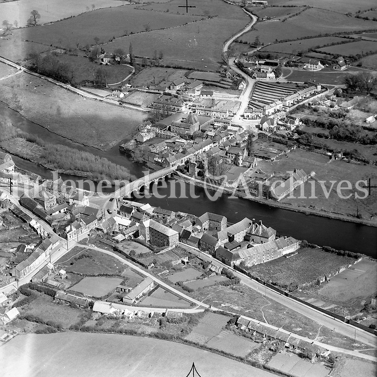 A254 Leighlandbridge (Leighlinbridge).   03/07/53. (Part of the Independent Newspapers Ireland/NLI collection.)<br /> <br /> <br /> These aerial views of Ireland from the Morgan Collection were taken during the mid-1950's, comprising medium and low altitude black-and-white birds-eye views of places and events, many of which were commissioned by clients. From 1951 to 1958 a different aerial picture was published each Friday in the Irish Independent in a series called, 'Views from the Air'.The photographer was Alexander 'Monkey' Campbell Morgan (1919-1958). Born in London and part of the Royal Artillery Air Corps, on leaving the army he started Aerophotos in Ireland. He was killed when, on business, his plane crashed flying from Shannon.