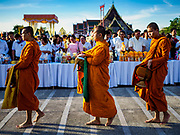 01 JANUARY 2019 - BANGKOK, THAILAND:   Buddhist novices walk to the beginning of the New Year's merit making ceremony on the plaza in front of City Hall in Bangkok. City Hall traditionally hosts one of the largest New Year merit making ceremonies in Thailand. This year about 160 monks participated in the event.      PHOTO BY JACK KURTZ