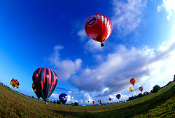 Stock photo of multiple hot air balloons at the Ballunar Liftoff Festival in Houston Texas