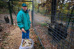 ROMANIA ZARNESTI 29OCT12 - Staff members prepare food and feed the bears at the Zarnesti Bear Sanctuary in Romania, funded by WSPA.....With over 160 acres (70 hectares) spread over a wooded hillside, it is Romania's first bear sanctuary and today houses 67 bears rescued from ramshackle zoos and cages at roadside restaurants.......jre/Photo by Jiri Rezac / WSPA......© Jiri Rezac 2012
