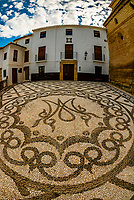"Intricate stone patterns called ""empedrados"", Calle Baja Iglesia,, Alhama de Granada, Granada Province, Andalusia, Spain."