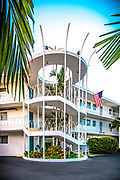 "The Bay Harbor Club apartments in the Miami Beach suburb of Bay Harbor Islands. This Space Age, Miami Modern (or MiMo) style from the 1950s and '60s is now being recognized as historically valuable and, in the view of some, worth preserving. This particular building, was the fictional home of the lead character in the television series ""Dexter."" The architect was Charles McKirahan, and it was built in 1956."