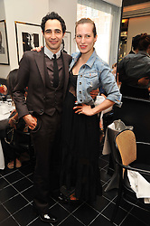 ZAC POSEN and CHARLOTTE DELLAL at a brunch hosted by Zac Posen to launch the Belvedere Bloody Mary Brunch held at Le Caprice, 25 Arlington Street, London on 7th April 2011.
