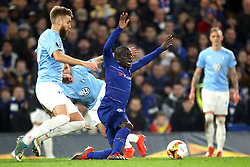Chelsea's N'Golo Kante (centre) is fouled during the game