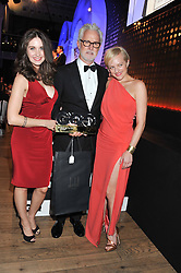 Left to right, ALISON BRIE, JOHN SLATTERY winner of the GQ International Man of The Year Award and ELISABETH MOSS at the GQ Men of The Year Awards 2012 held at The Royal Opera House, London on 4th September 2012.