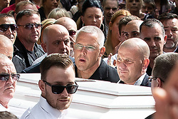 © Licensed to London News Pictures . Salford , UK . File picture of JOHN KINSELLA (centre) carrying Paul Massey's coffin at Paul Massey's funeral , in Salford , on 28th May 2015. Police have arrested several men in connection with the murders of both Kinsella and Massey. Photo credit : Joel Goodman/LNP