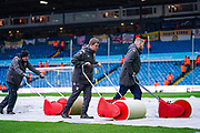 Leeds United ground staff prepare the Elland Road pitch during the EFL Sky Bet Championship match between Leeds United and Bristol City at Elland Road, Leeds, England on 15 February 2020.