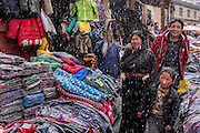 Heavy snow falls on the clothing market in the town of Zado, Tibet (Qinghai, China).