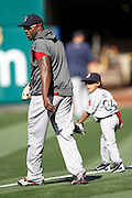 ANAHEIM, CA - APRIL  23:  David Ortiz #34 of the Boston Red Sox walks with his son D'Angelo Ortiz while the team warms up before the game between the Boston Red Sox and the Los Angeles Angels of Anaheim on Saturday, April 23, 2011 at Angel Stadium in Anaheim, California. The Red Sox won the game in a 5-0 shutout. (Photo by Paul Spinelli/MLB Photos via Getty Images) *** Local Caption *** David Ortiz