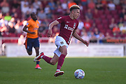 Northampton Town midfielder Shaun McWilliams (17) sprints forward with the ball  during the EFL Sky Bet League 1 match between Northampton Town and Oldham Athletic at Sixfields Stadium, Northampton, England on 5 May 2018. Picture by Dennis Goodwin.