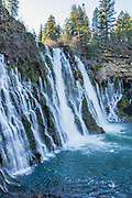 Burney Falls is a beautiful National Natural Landmark on Burney Creek in McArthur-Burney Falls Memorial State Park, Shasta County, California, USA. The water comes from underground springs above and at the falls, which plunges 129 feet. The waterfall was named after pioneer settler Samuel Burney who lived nearby in the 1850s. The McArthurs settled nearby in the late 1800s and their descendants saved the waterfall from development, bought the property and gifted it to the state in the 1920s. The park is northeast of Redding, six miles north of Highway 299 on Highway 89 near Burney. The Pacific Crest Trail passes through the park.
