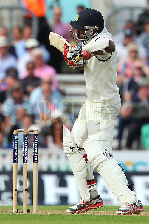 Varun Aaron of India is hit by a delivery from Chris Jordan of England during day one of the fifth Investec Test Match between England and India held at The Kia Oval cricket ground in London, England on the 15th August 2014<br /> <br /> Photo by Ron Gaunt / SPORTZPICS/ BCCI