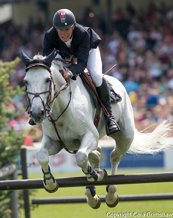 BEN ASSELIN (CAN) rides DOREMI in the 1.50m Derby Nexen Cup during National CSI 5* at Spruce Meadows presented by Rolex, June 7 2015. Calgary.