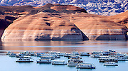 Houseboats sit unused as the sandstone cliffs near the Bullfrog marina in Utah show signs of the decreasing water level at Lake Powell.