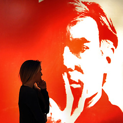 An Andy Warhol self-portrait, hidden from view for much of its life, has sold for more than £10m - double the expected price. ©London News pictures. 08.02.2011. A woman holds a rediscovered self-portrait by Andy Warhol. The picture painted in 1967 which has been in a private collection since 1974 is expected to realise 3 million to 5 million pounds. A preview, today (Fri) of Christie's Auction House Post-War and Contemporary Art Evening Auction. The sale is expected to make a combined total of £46,246,000 to £66,447,000 when it is sold on 16th Feb 2011.. Picture Credit should read Stephen Simpson/LNP