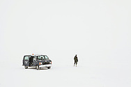 A Canadian Forces officer stands outside his van on a whiteout weather outside Resolute Bay during Nunalivut 2012 sovereignty exercise. 20 April 2012. Rangers are army units that mix local volunteers, here Inuits, and professional military acting as eyes and ears in the most remote areas of northern Canada.