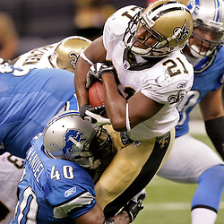 2009 September 13: Detroit Lions safety Marquand Manuel (40) hits New Orleans Saints running back Mike Bell (21) during a 45-27 win by the New Orleans Saints over the Detroit Lions at the Louisiana Superdome in New Orleans, Louisiana.