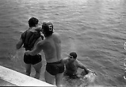14/07/1967<br /> 07/14/1967<br /> 14 July/1967<br /> PAK sponsored Sandycove Diving Gala at Blackrock Baths, Dublin. Image shows one of the comedy races in which two teams, Lansdowne selected verses the Rest of Leinster Selected had to win across the baths, changing their jerseys at each side.