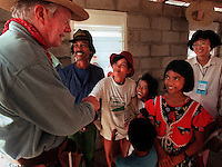 Elpie Sara, center, reaches out to shake hands with former president Jimmy Carter, right, during the final day of construction. After working long days in the hot Filipino sun Carter visited each of the 130 houses in Isaiah Ville to insure construction was on schedule.  (From left, Jimmy Carter, Marcelo Sara, Elpie Sara, Rina Sara, 9, Leonor Sara, 12, and World Vision volunteer Wei Hui Young of Singapore.(Janet Jensen/The News Tribune)