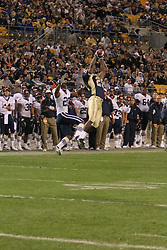 Pittsburgh defensive back Darrelle Revis (25) intercepts a pass intended for Virginia wide receiver Kevin Ogletree (20).  The Virginia Cavaliers fell to the Pittsburgh Panthers 38-13 on September 2, 2006 at Heinz Field in Pittsburgh, PA.