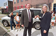 The positive impact of hosting the Republican Convention is already evident. DaimlerChrysler zone manager, Rick Ciesla, center, hands the keys to a new minivan to Lydia Hernandez-Valez of ASPIRA, Inc., Thursday, July 13, 2000, in Philadelphia.  The new vehicle is part of a $25,000 contribution made to the organization by DaimlerChrysler, a major sponsor of the Republican Convention. (Photo by William Thomas Cain)
