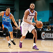 Reno Bighorns Guard AARON HARRISON (1) drives away from Oklahoma City Blue Forward JUSTIN LEON (11) during the NBA G-League Basketball game between the Reno Bighorns and the Oklahoma City Blue at the Reno Events Center in Reno, Nevada.