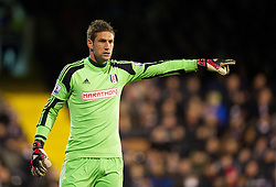 LONDON, ENGLAND - Wednesday, February 12, 2014: Fulham's goalkeeper Maarten Stekelenburg in action against Liverpool during the Premiership match at Craven Cottage. (Pic by David Rawcliffe/Propaganda)