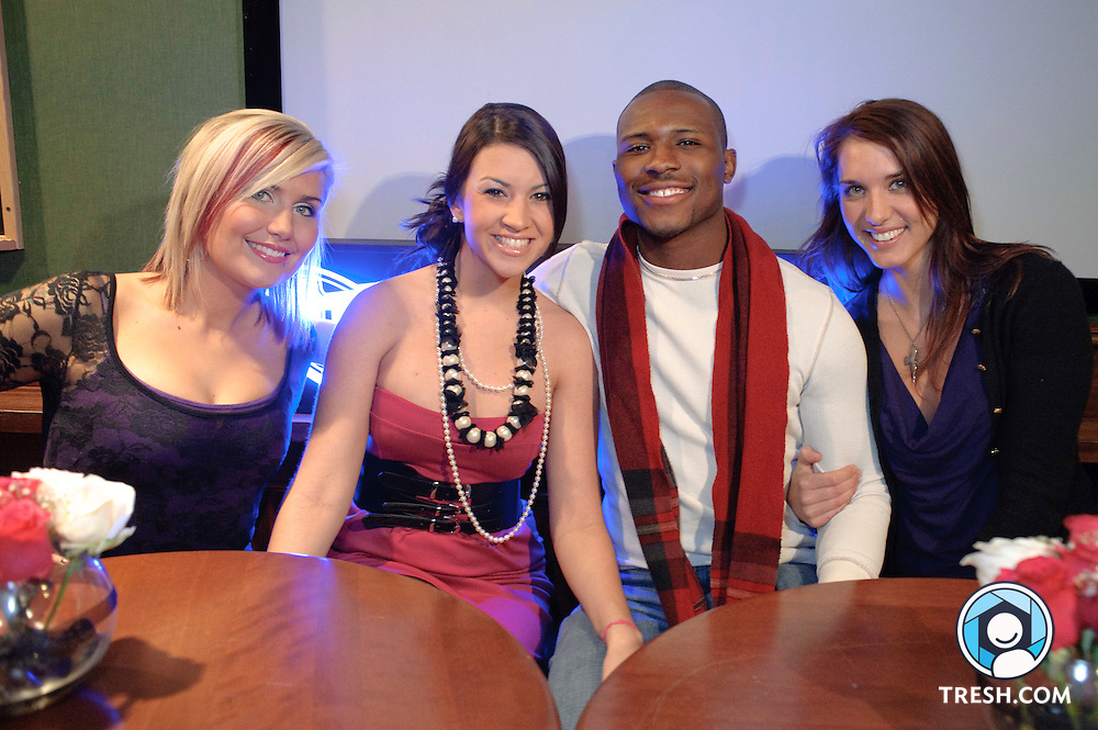 """Callie Walker, Ashley Lindley, Ty Ruff, and Emily Schromm (L to R) - four of eight cast members of MTV's """"The Real World: Washington D.C."""" - pose for photographs prior to a showing of the premiere episode at BlackFinn DC, Wednesday December 30, 2009."""