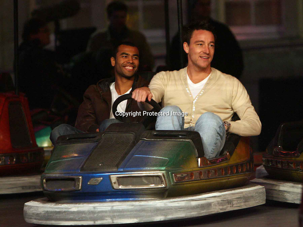 john terry and ashly cole at a fair ground in central london.15.12.06<br /> pix