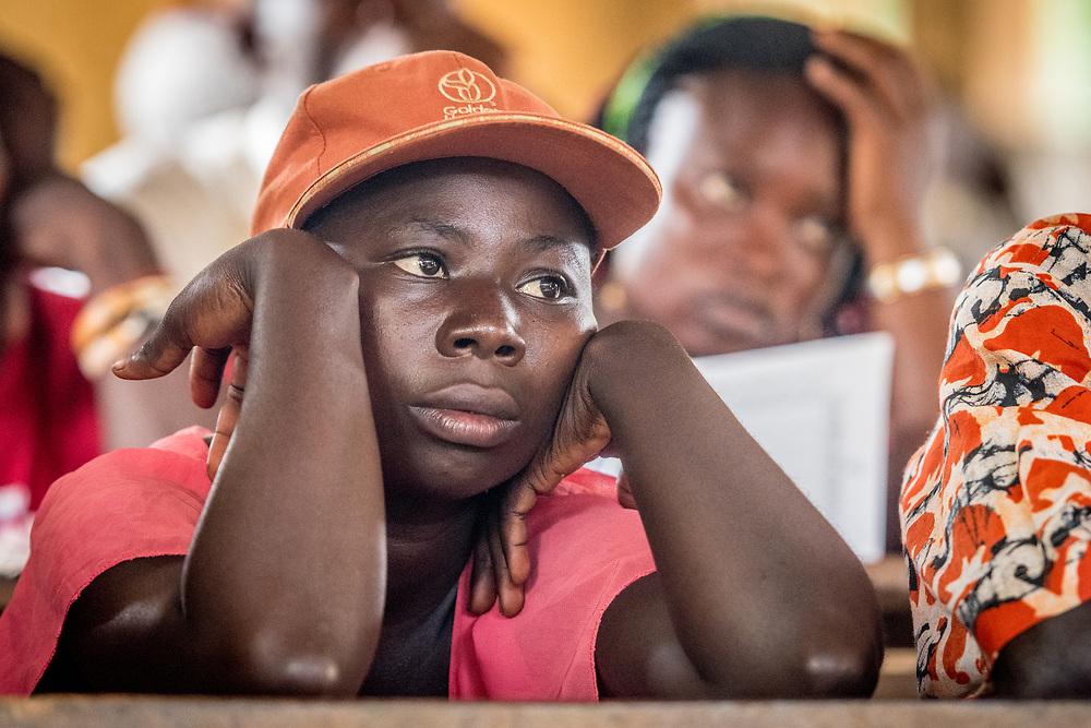A boy focuses on a lesson in Ganta, Liberia