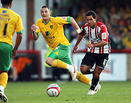 London - Tuesday, August 18th, 2009: Sam Wood of Brentford and Michael Spillane of Norwich City during the Coca Cola League One match at Griffin Park, London. (Pic by Chris Ratcliffe/Focus Images)