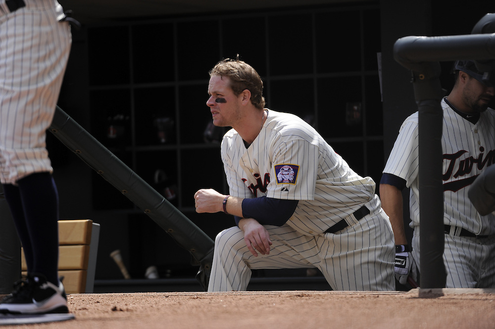 MINNEAPOLIS - APRIL 24:  Justin Morneau #33 of the Minnesota Twins looks on against the Cleveland Indians on April 24, 2011 at Target Field in Minneapolis, Minnesota.  The Twins defeated the Indians 4-3.  (Photo by Ron Vesely)  Subject:  Justin Morneau