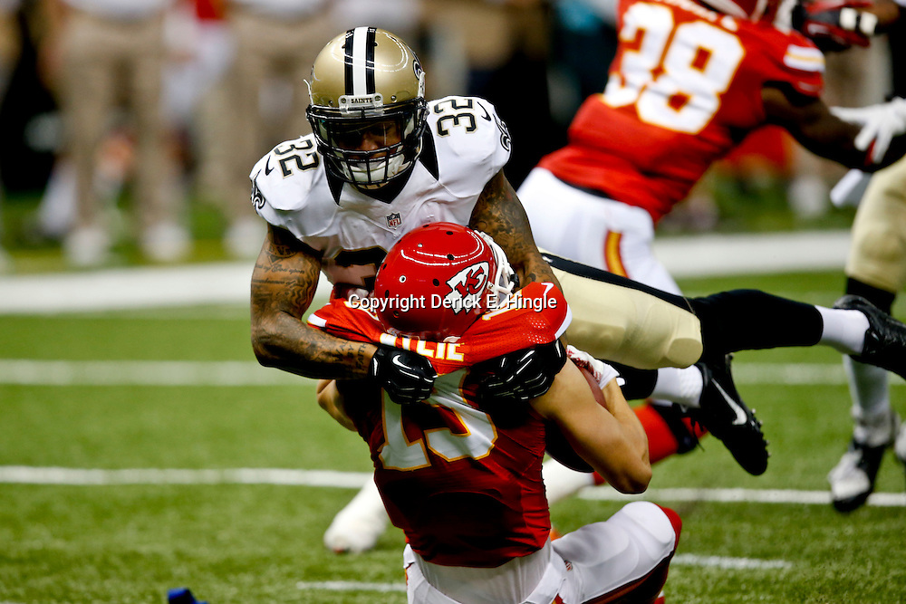 Aug 9, 2013; New Orleans, LA, USA; New Orleans Saints strong safety Kenny Vaccaro (32) tackles Kansas City Chiefs wide receiver Devon Wylie (19) during the second quarter of a preseason game at the Mercedes-Benz Superdome. Mandatory Credit: Derick E. Hingle-USA TODAY Sports
