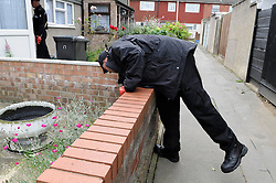 © Licensed to London News Pictures. 07/08/2012 . A Police officer searching door to door gardens, sheds and garages in the New Addington area in the hunt for missing Tia Sharp. 12 year old Tia Sharp has been missing from the Lindens on The Fieldway Estate in New Addington since Friday last week. .Photo credit : Grant Falvey/LNP