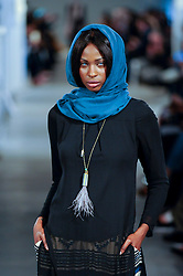 © Licensed to London News Pictures. 18/02/2017. London, UK.  A model presents a look by iiLa (London) at the UK's first London Modest Fashion Week taking place this weekend at the Saatchi Gallery.  The two day event sees 40 brands from across the world come together to showcase their collections for Muslim and other religious women. Photo credit : Stephen Chung/LNP