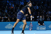 Roger Federer serves during the final of the ATP World Tour Finals between Roger Federer of Switzerland and Novak Djokovic at the O2 Arena, London, United Kingdom on 22 November 2015. Photo by Phil Duncan.