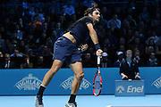 Roger Federer serves during the final of the ATP World Tour Finals between Roger Federer of Switzerland and Novak Djokovic at the O2 Arena, London, United Kingdom on 22 November 2015. Photo by Phil Duncan.