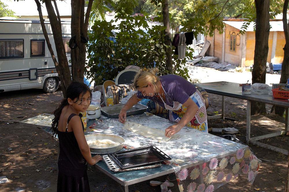 Rome  July 24 2008.Rom's camp Casilino 900.Romani woman of Bosnia prepares the lunch.