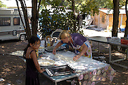 Rome  July 24 2008.Rom's camp Casilino 900.Romani woman of Bosnia prepares the lunch.