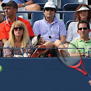A young boy asleep while Andy Murray, Great Britain, in action during his Men's singles first round victory against Alex Bogomolov, Russia, during the US Open Tennis Tournament, Flushing, New York. USA. 27th August 2012. Photo Tim Clayton