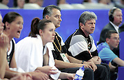 Tall Ferns coach Carl Dickel sits on the bench with assistant coach Tracy Carpenter during the Women's basketball match between the New Zealand Tall Ferns and Poland at the Olympics in Sydney, Australia on 16 September, 2000. Photo: Dean Treml/PHOTOSPORT<br />