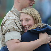5/5/11 -- TOPSHAM, Maine. Lance Cpl. Josh Farrell hugs his girlfriend, Brianna Turcotte prior to departing on deployment. U.S. Marine Reservists departed from Topsham on Thursday for the start of a year-long deployment to Afghanistan amidst a crowd of family, friends and well-wishers. This mission will be different from others, said several Marines, because instead of doing combat operations they will be teaching the Afghan National Army to operate independently. They travel first to California for several months of training and are planning to return in May 2012. Photo by Roger S. Duncan.