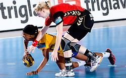 Carero de Moraes  of Hypo  and  Tamara Mavsar of Krim at handball match of Round 3 of Champions League between RK Krim Mercator and Hypo Niederosterreich, on November 8, 2009, in Arena Kodeljevo, Ljubljana, Slovenia.  Krim won 35:24. (Photo by Vid Ponikvar / Sportida)