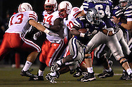 Kansas State running back Leon Patton (14) rushes past Nebraska linebacker Corey McKeon (13) at Bill Snyder Family Stadium in Manhattan, Kansas, October 14, 2006.  The Huskers beat the Wildcats 21-3.<br />
