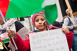 Kesnington, London, July 11th 2014. A boy with his message as thousands of Palestinians and their supporters demonstrate against the latest wave of Israeli retaliatory attacks on Palestinian targets and homes, where casualties are steadily mounting.