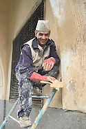 A plasterer working on restoration of<br /> The Winter Canal<br /> St Petersburg, Russia<br /> c. Ellen Rooney
